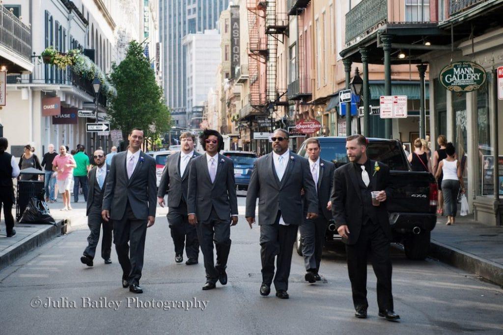 Groomsmen walking down New Orleans street